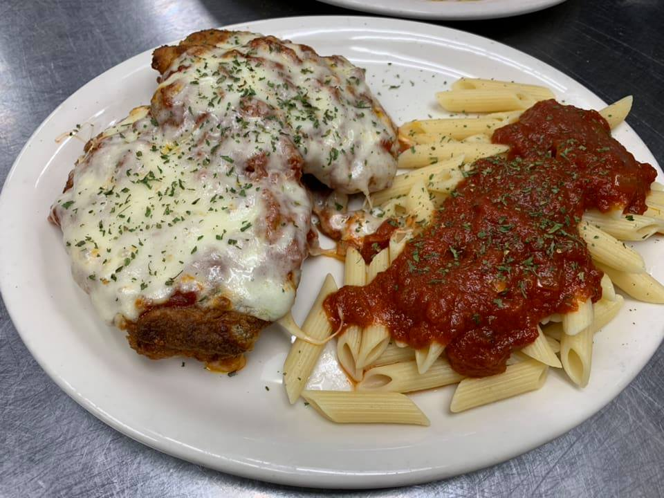 Chicken Parmesan with a side of Penne pasta and tomato sauce