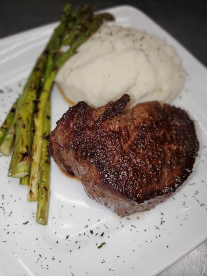 Steak with a side of asparagus and mashed potatoes