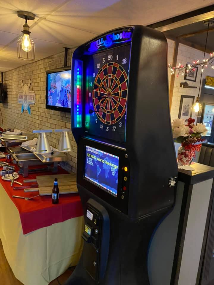 A darts game machine at a catering event