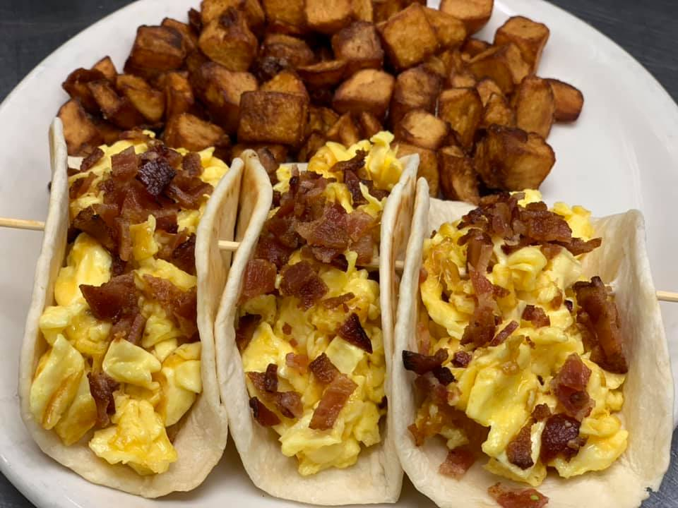 Breakfast egg and bacon tacos with a side of home fries