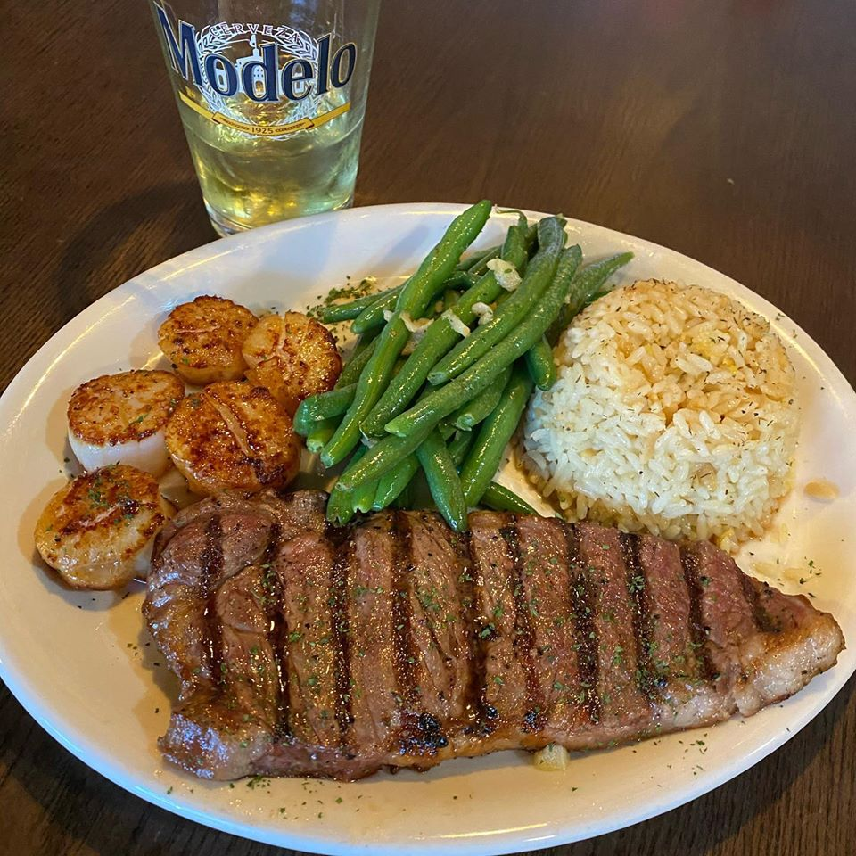 Steak with a side of green beans and rice