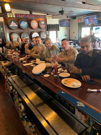 Our Army customers sitting at the bar and enjoying a drink