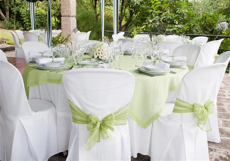 event set up with table cloths, linen napkins, and other decorations