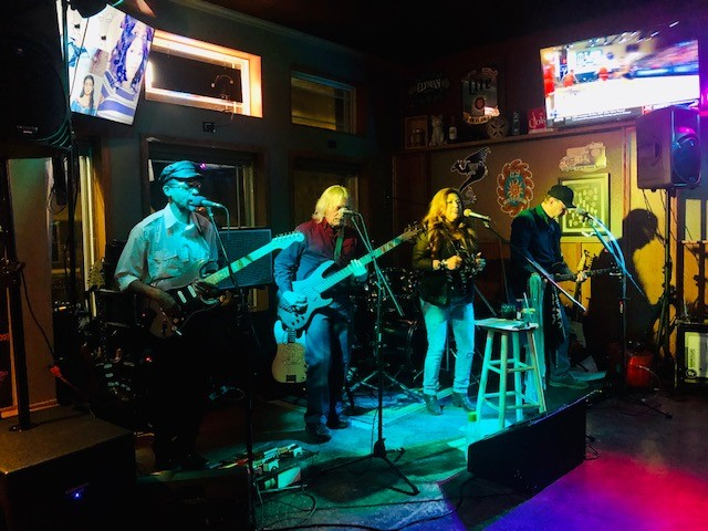 band playing on stage at Doghouse Tavern