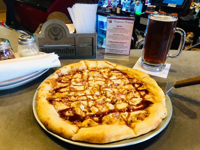 BBQ Chicken Pizza: Hand-tossed pizza with mozzarella cheese, fresh-cooked chicken, red onion and our house-made Doghouse BBQ sauce, all cooked to perfection in our stone pizza oven.