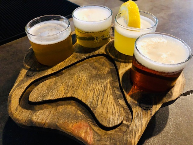paw print shaped flight with 4 assorted beers