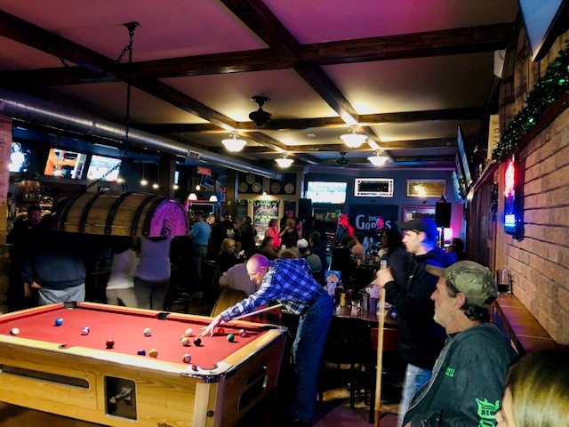 customers playing billiards at doghouse tavern
