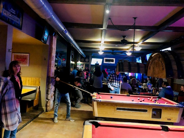 people playing pool inside the restaurant