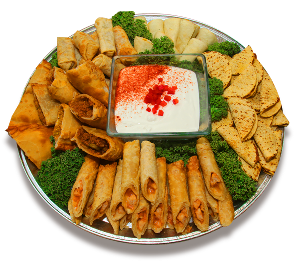 A platter filed with various types of eggrolls for a catering event
