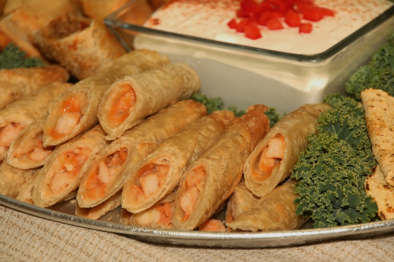 A tray filled with cut eggrolls