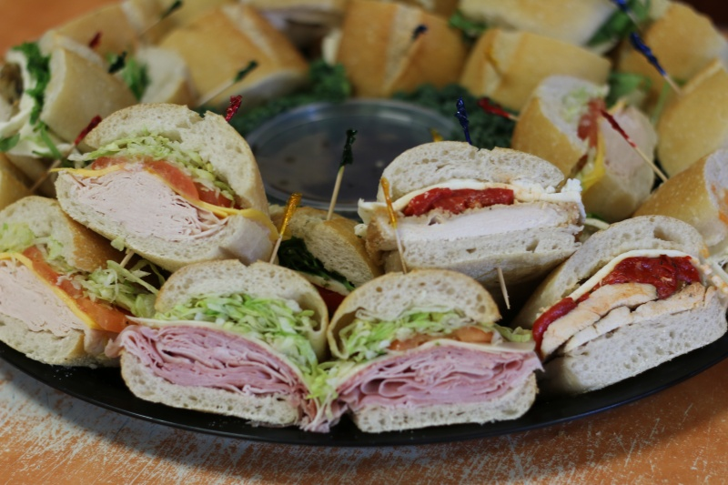 A tray filled with various pre-made sandwiches