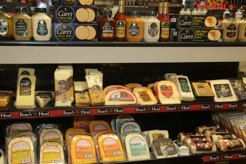 Cheese and dairy products on a shelf