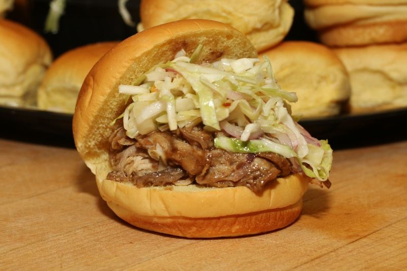 Pulled pork on a roll and topped with coleslaw