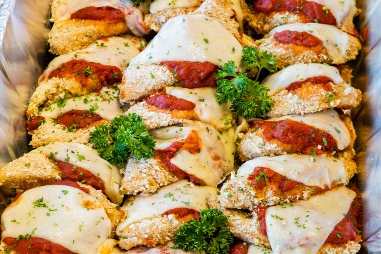 A tray filled with chicken parmesan