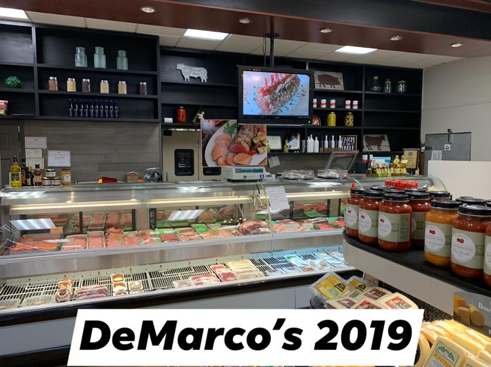 The inside of DeMarco's in 2019. Brand new front counter with display cases of food and many selves of products