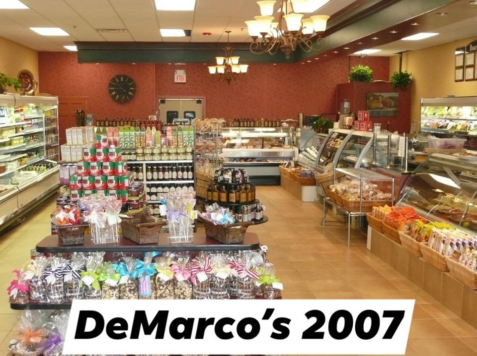 The inside of DeMarco's in 2007 with a front counter and shelves of products