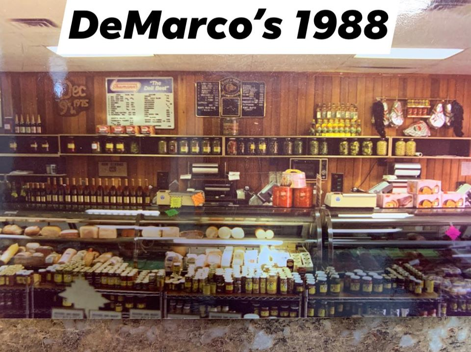 DeMarco's in 1988 with wood paneling shelves behind a small counter