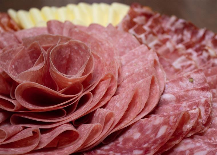 Rolled cold cuts, such as provolone, and salami, on a platter