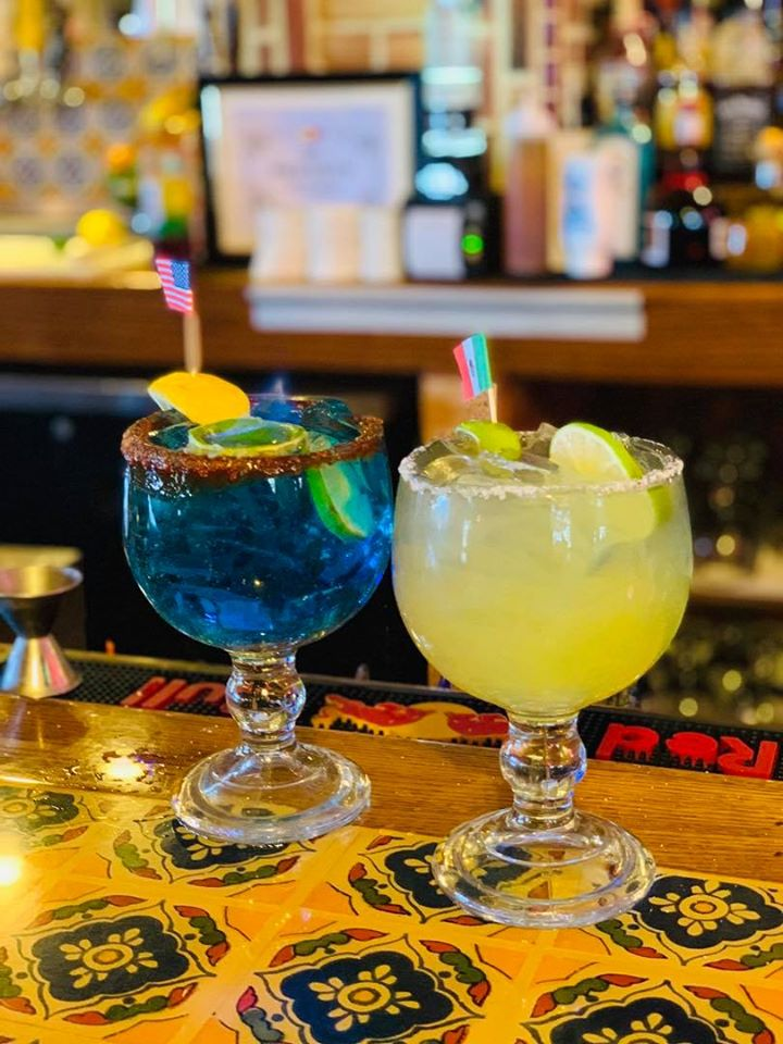 two flavored margaritas on the bar