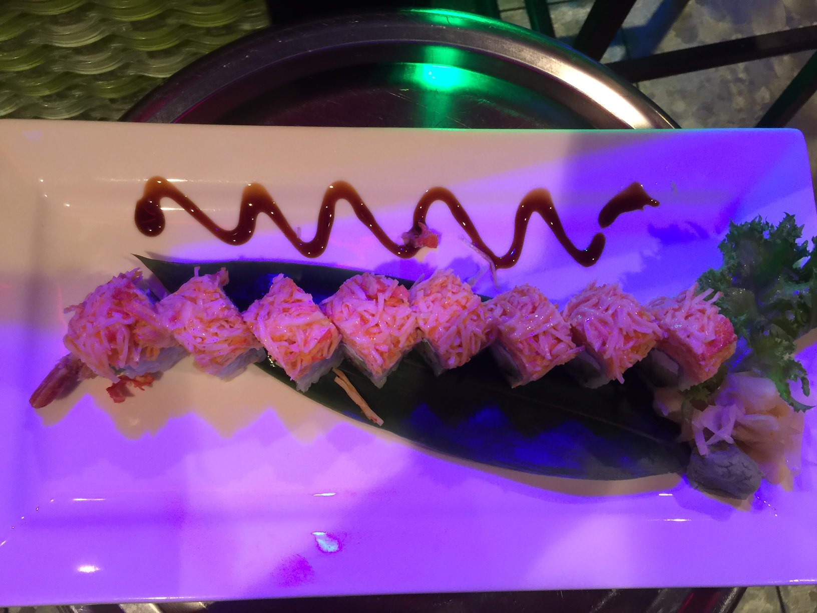 sushi roll with teriyaki drizzle