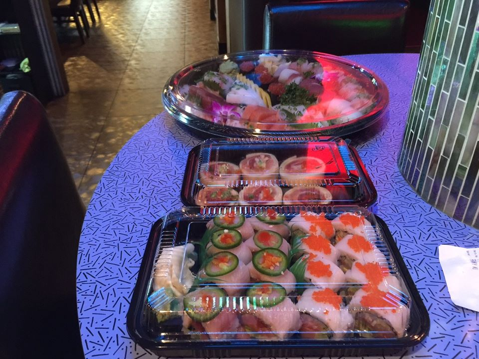 large takeout containers of sushi