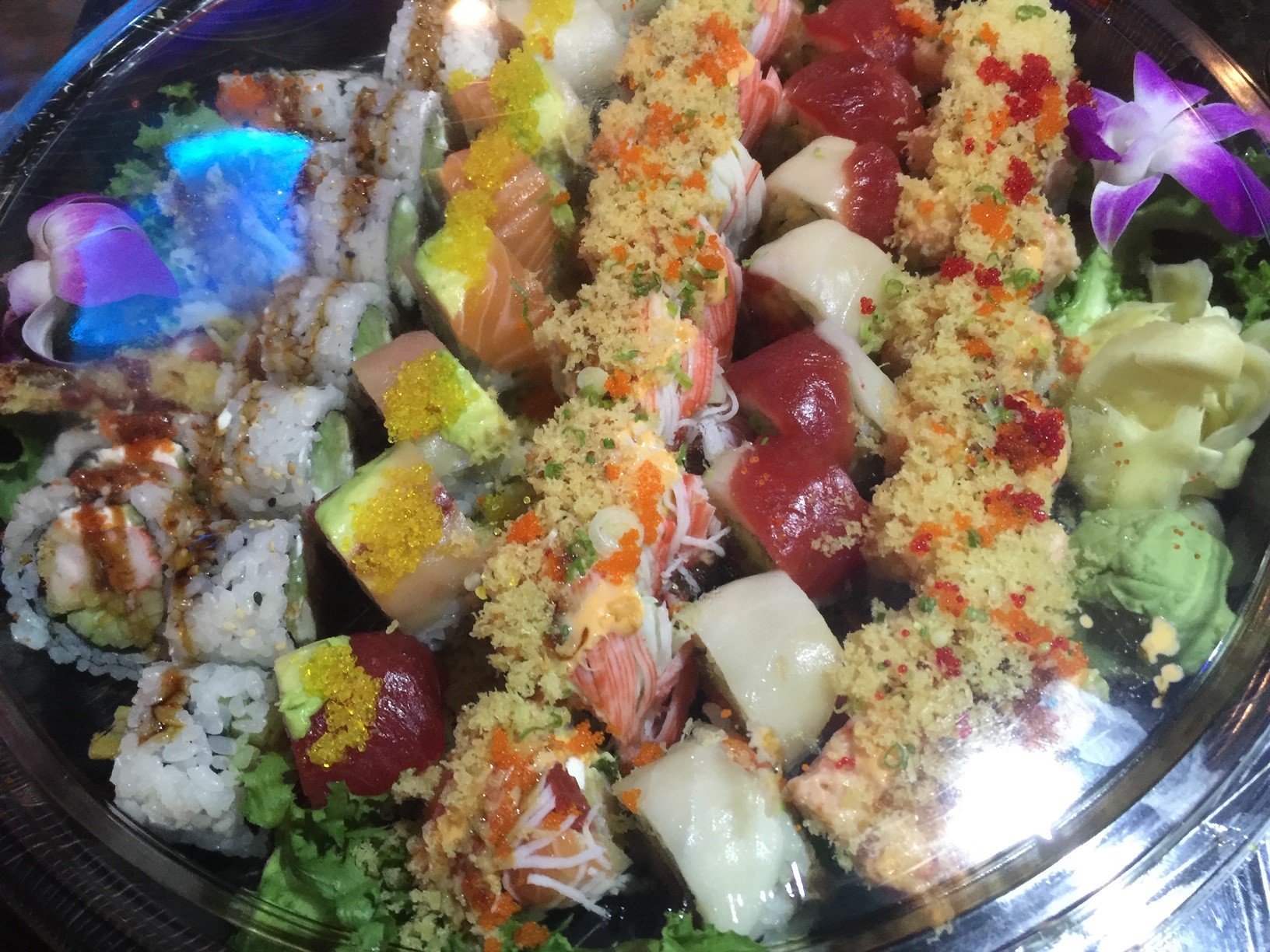 close up picture of a sushi platter to go