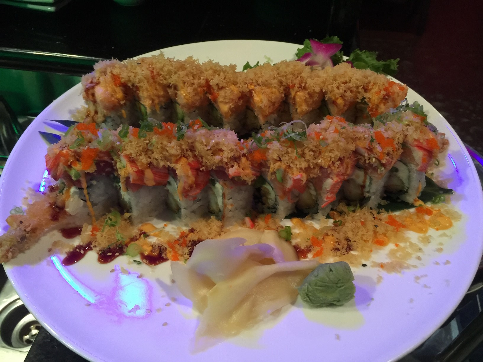 sushi covered in spicy mayo