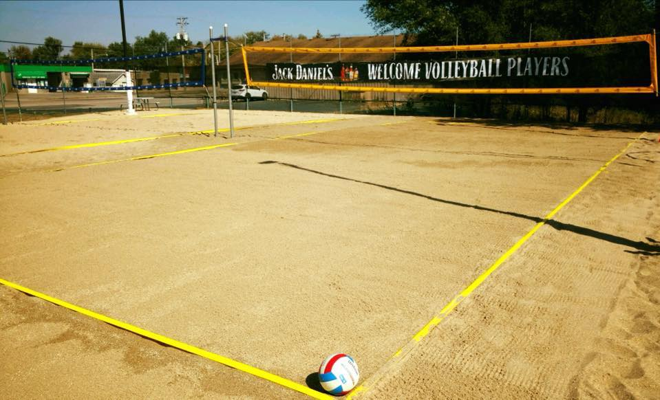 sand volleyball court outside Louie's tap house