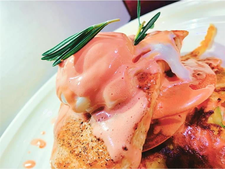 Salmon Benedicto: Veggie potato cakes topped with grilled tomato, fresh dill, grilled salmon, poached egg & finished with beet hollandaise sauce
