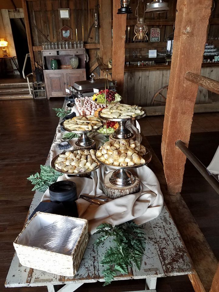 a buffet table filled with a variety of food