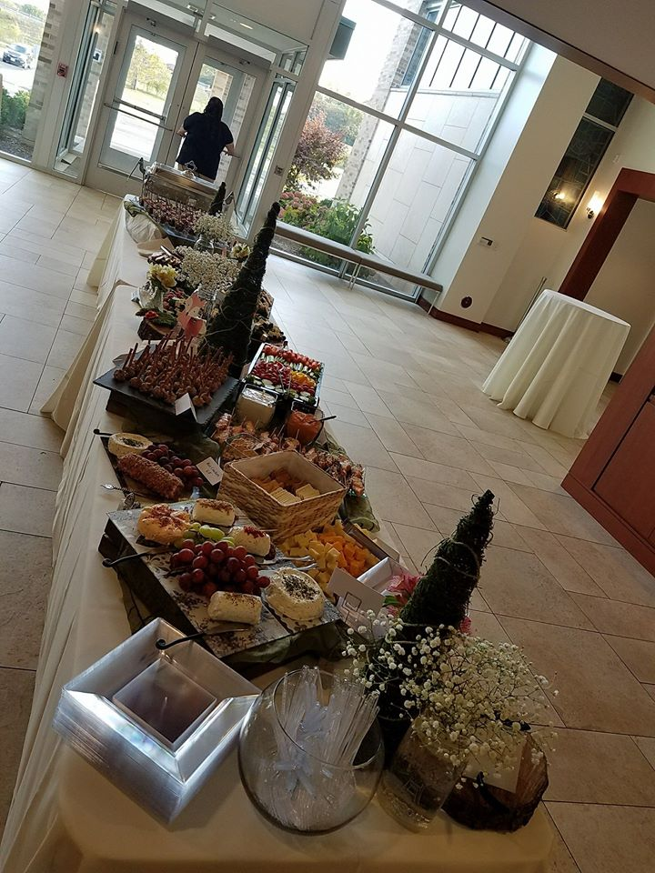 a tray filled with mixed foods served buffet style