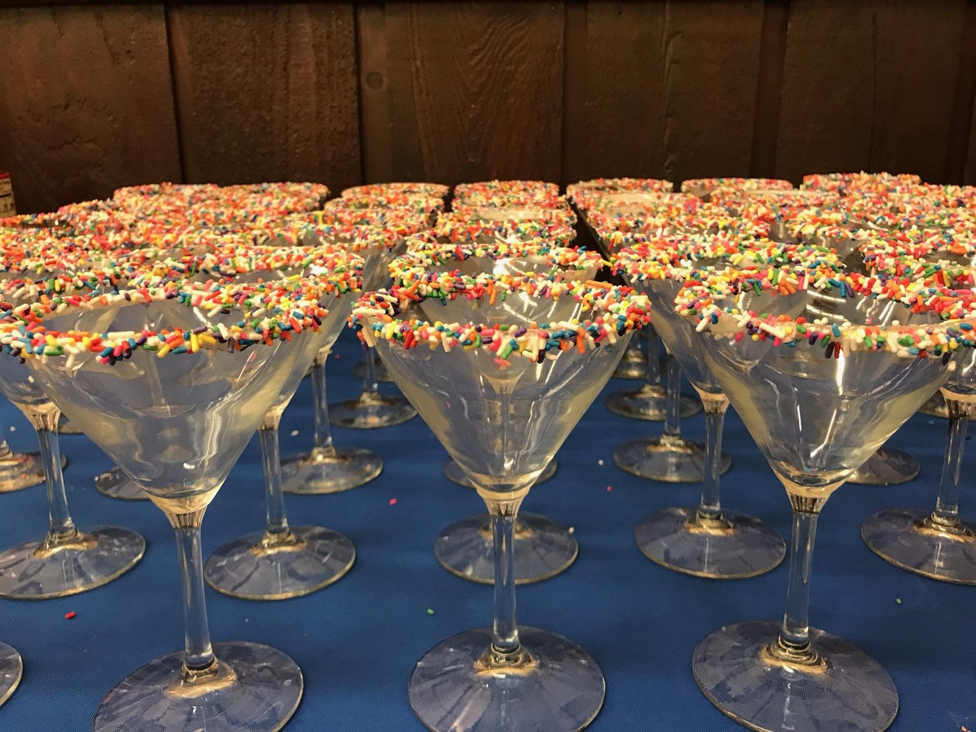 martini glasses with sprinkles around the rim
