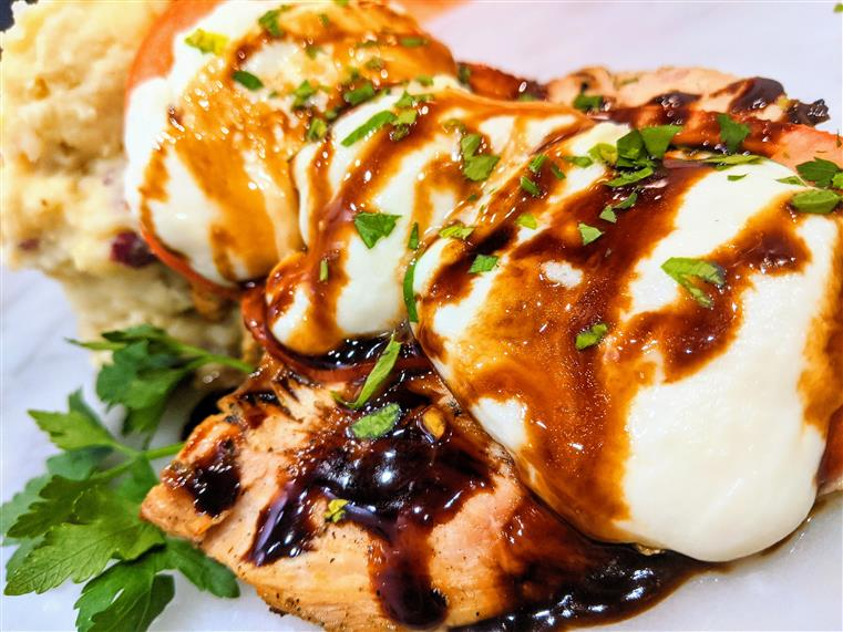 grilled chicken with roasted tomatoes, fresh basil, melted mozzarella cheese and balsamic glaze