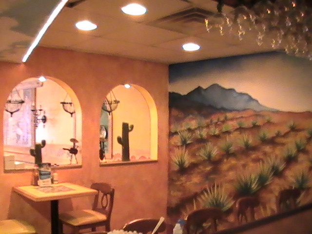mural painted on wall of dining room area
