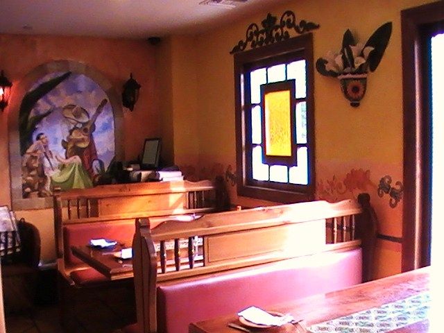 booths at Hacienda Don Manuel with stained glass window
