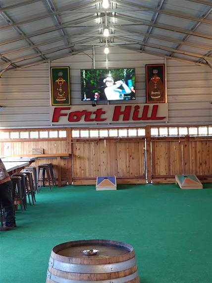 Fort Hill lounge area with cornhole game