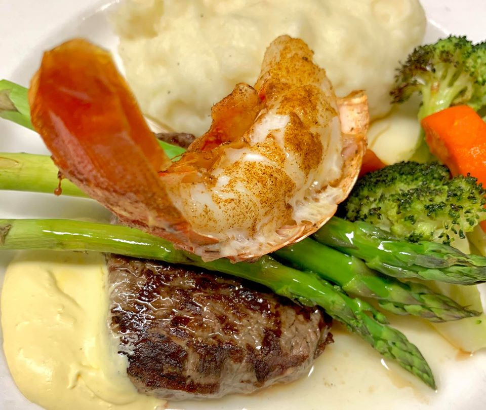 grilled steak and shrimp with mashed potatoes and vegetables