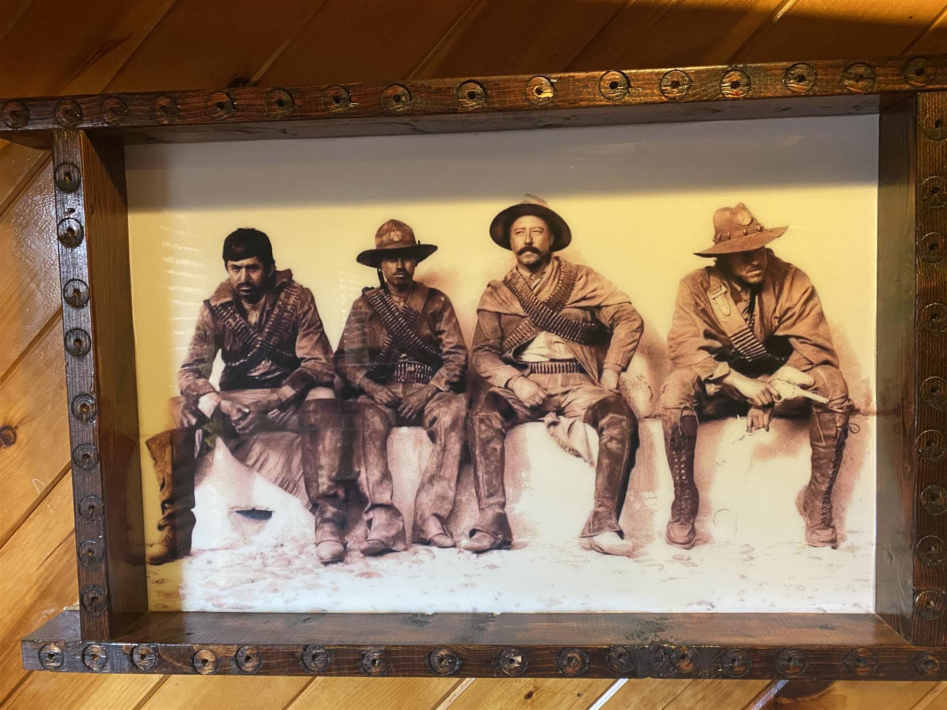 vintage photo of mexican soldiers sitting on a ledge