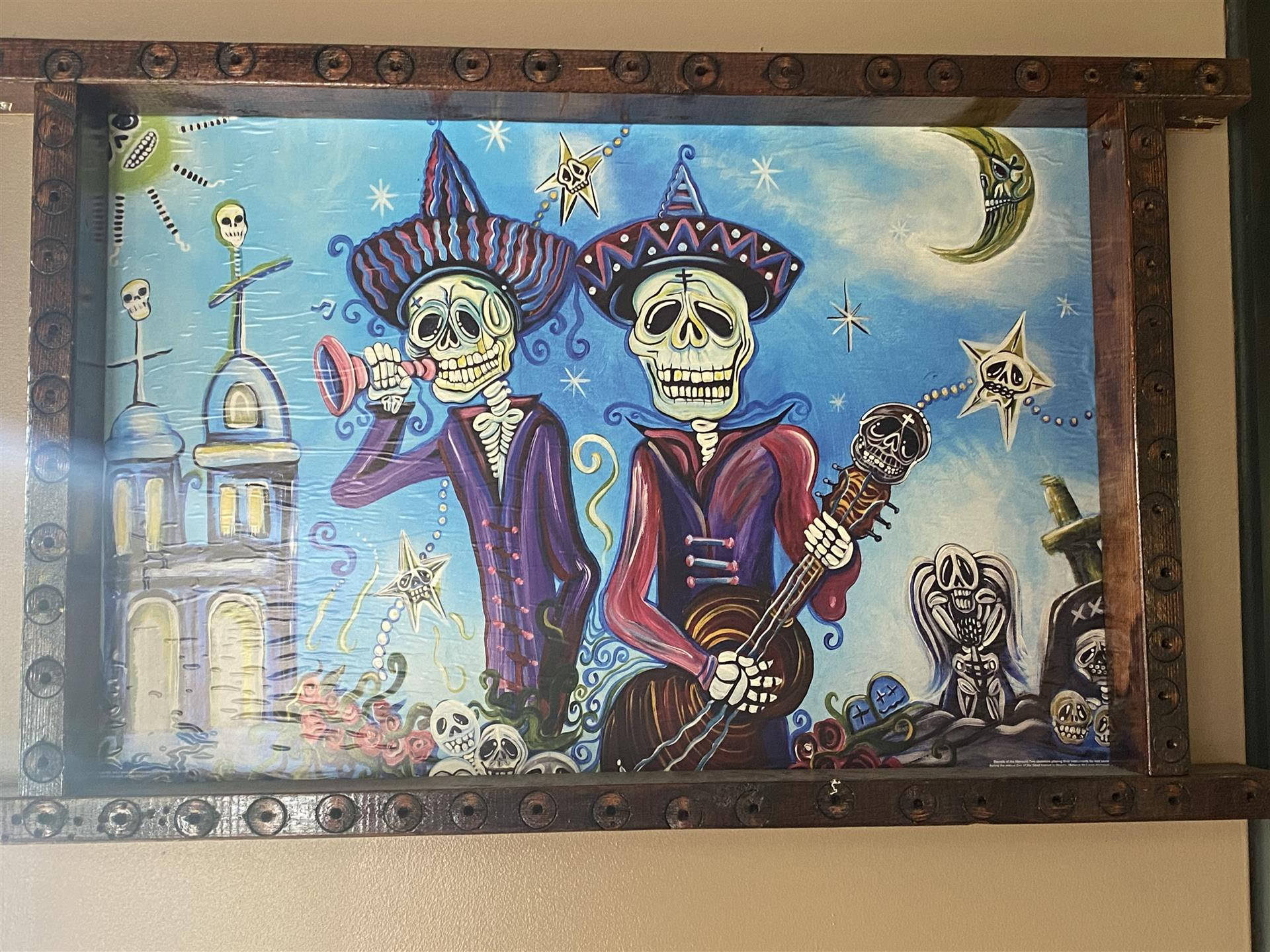 drawing of skeletons playing guitar and the horn at night