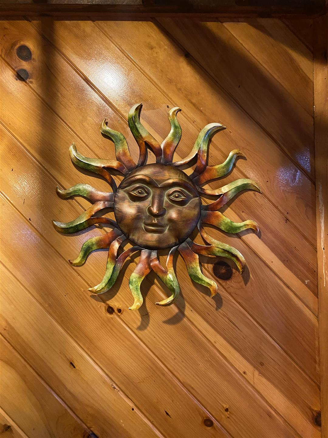 metal sun with face wall decoration