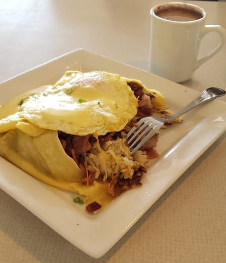 meatlovers omelette and hash with a cup of coffee
