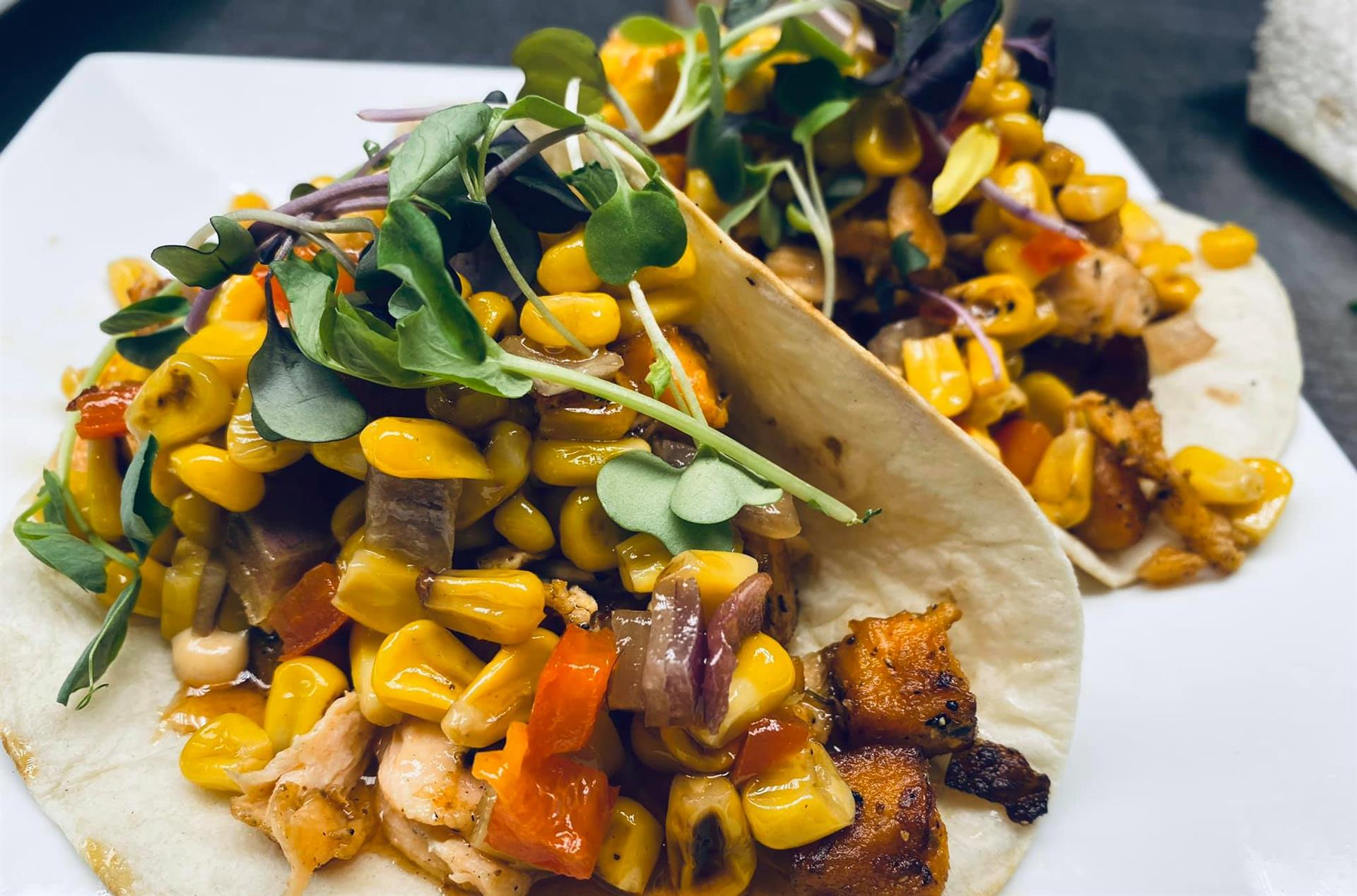 tacos with chicken, corn and peppers