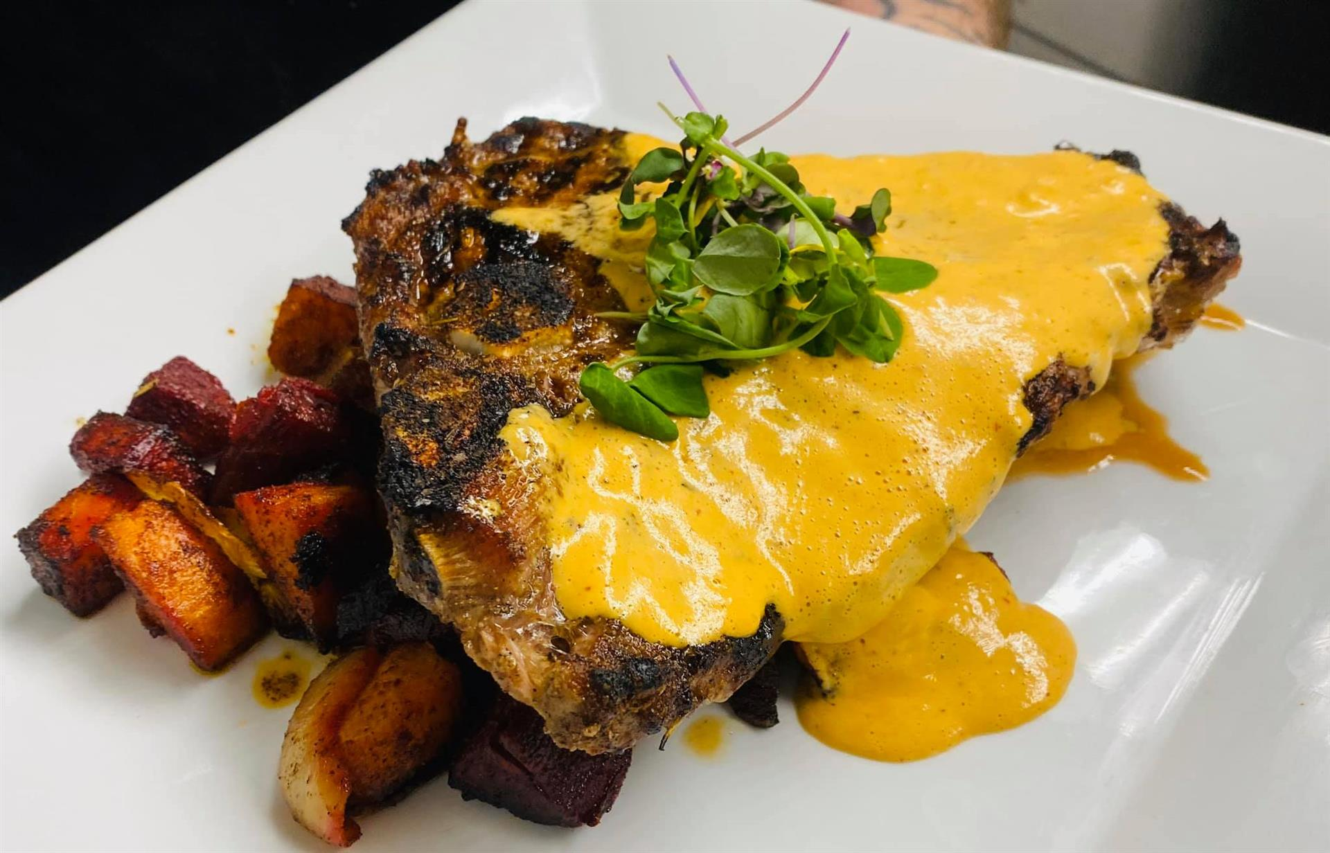 16oz Porterhouse Steak with Chipotle Hollandaise and Cumin Roasted Root Vegetable Medley