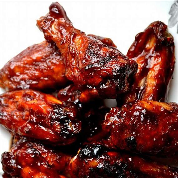 chicken wings covered in barbecue sauce