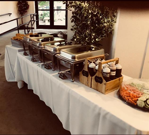 table setup againt a wall for a party with trays of food