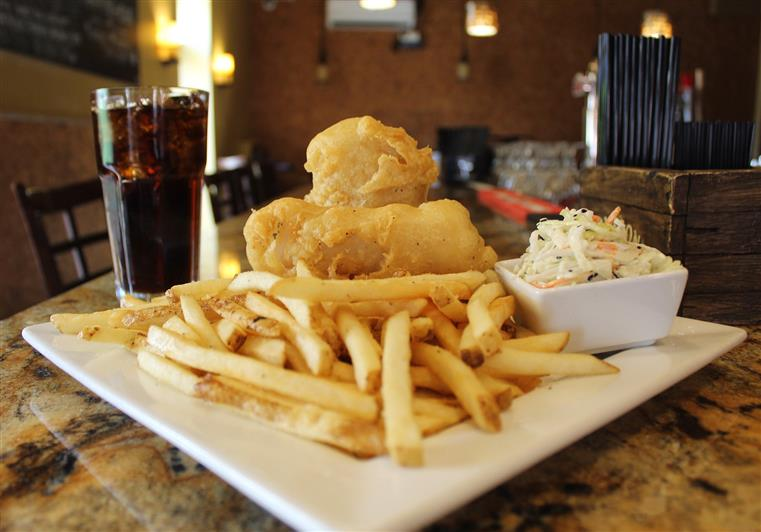 Fish and Chips: Two large pieces of beer pattered hand dipped cod served with fries and coleslaw
