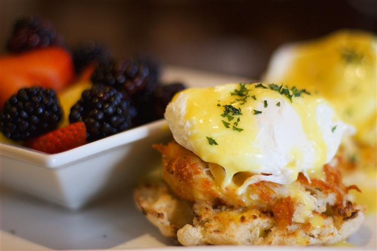 crab eggs benedict: eggs benedict with crab meat, side of berries
