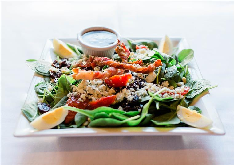 spinach salad: Baby spinach, roasted tomatoes, bleu cheese crumbles, dried cherries, hard-boiled egg, and sweet bacon twists. Served with balsamic dressing