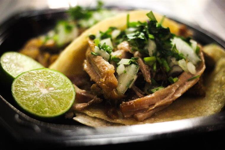 shredded pork tacos with cilantro and lime