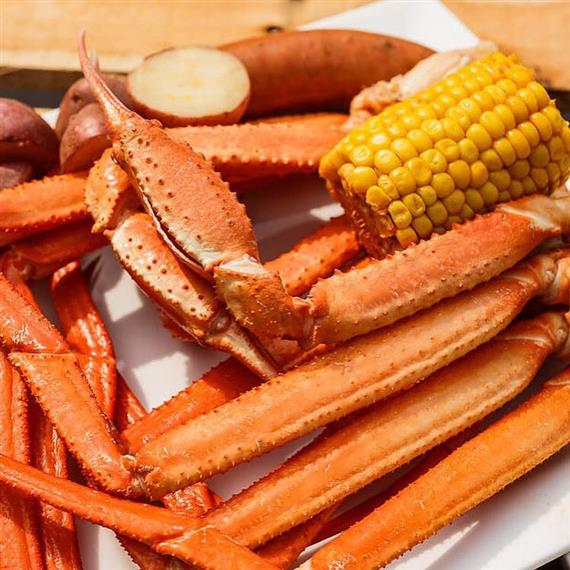 king crab legs, potatoes, sausage, and corn on the cob